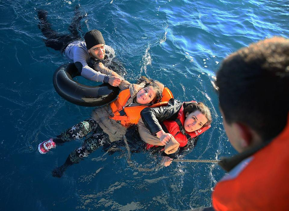 <p>2016. Getty Caption: Turkish Coast Guard personnel help refugees as they swim with buoys, after they toppled over a fishermen dinghy en route to Greece on January 22, 2016 in Didim district of Aydin, Turkey. 4 refugees body including 3 children pulled out of the water as Turkish coast guard personnel rescued 43 others. </p>