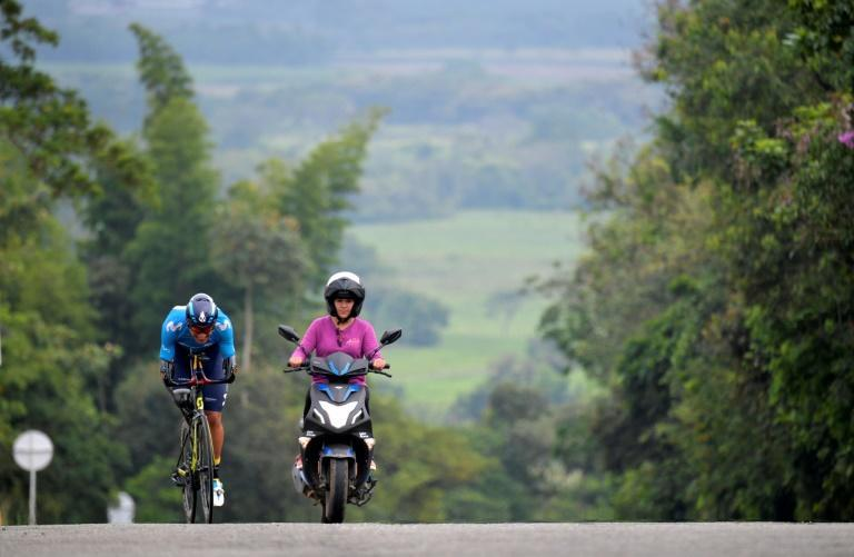 Colombian paralympian Juan Jose Florian putting in miles of training around his home town of Granada, Colombia, led by his wife and coach Angie Garces, in November 2020