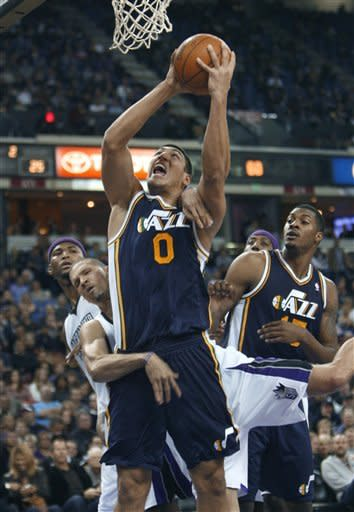 Utah Jazz center Enes Kanter (0), from Turkey, is fouled under the basket by Sacramento Kings defender Francisco Garcia during the first half of an NBA basketball game in Sacramento, Calif., Tuesday, Feb. 28, 2012. (AP Photo/Steve Yeater)