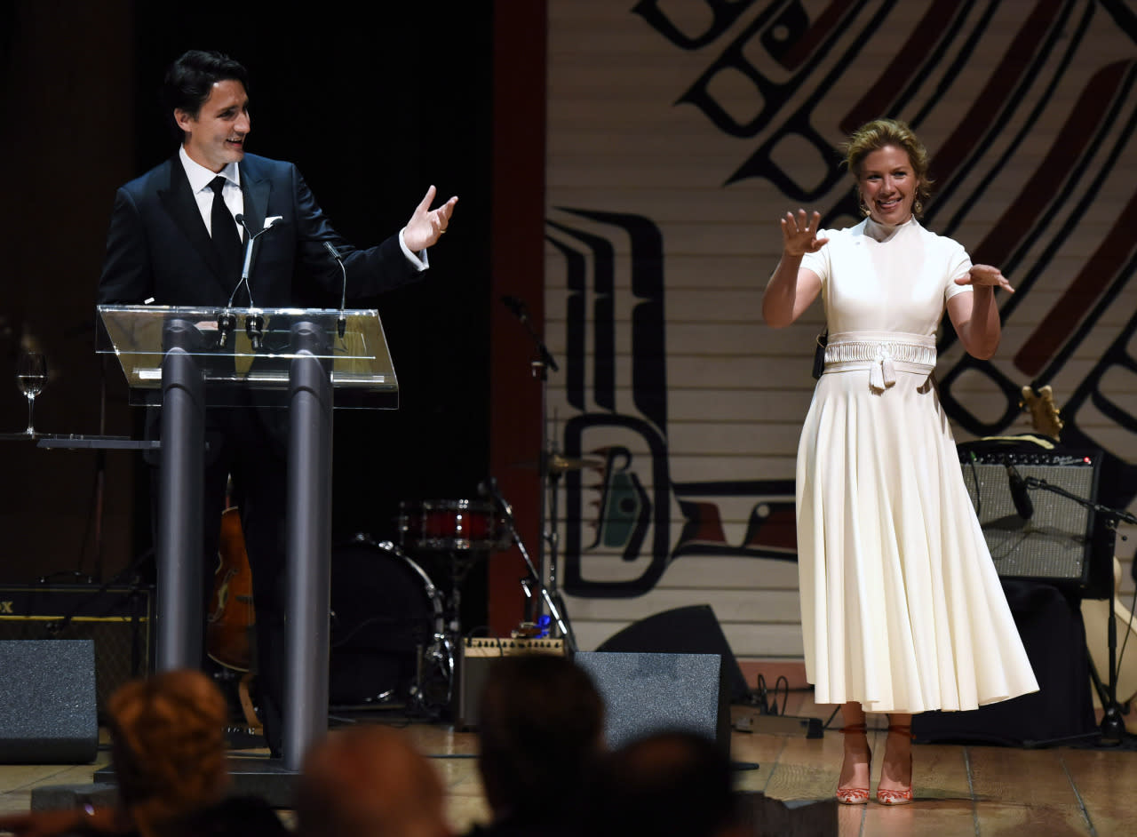 "<p>For the event, which insiders often refer to as ""Nerd Prom,"" Prime Minister Trudeau jokingly asked his wife what she was wearing. After exclaiming, ""Oh my God, thank you <i>so</i> much for asking,"" she then jumped into an exaggerated description, ensuring the crowd that she was wearing Canadian. In case you're wondering (we always are), her gorgeous white dress is by UNTTLD.  <i>(Photo by Justin Tang/The Canadian Press)</i><br /><br /></p>"