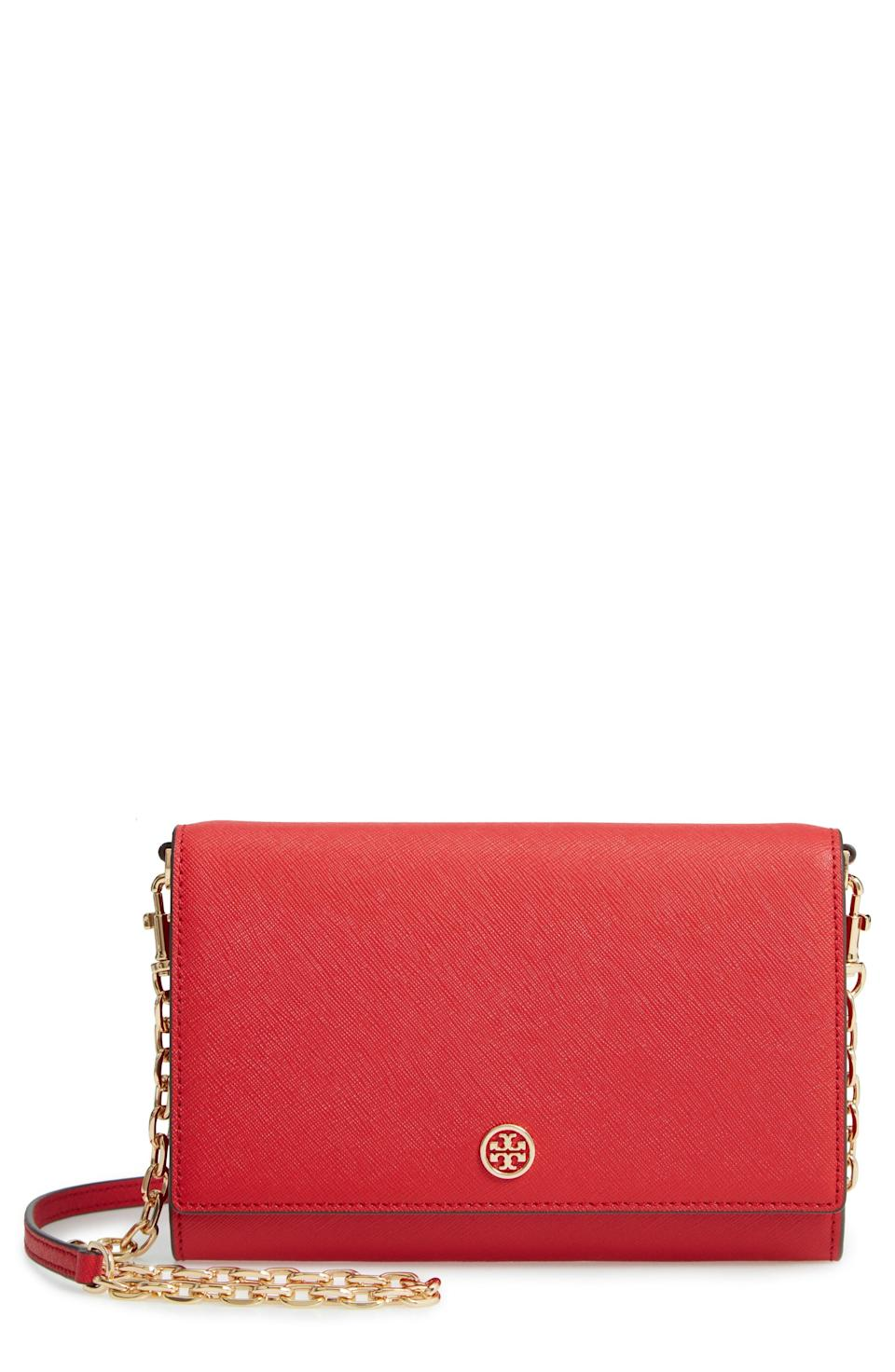 """<p><strong>TORY BURCH</strong></p><p>nordstrom.com</p><p><strong>$298.00</strong></p><p><a href=""""https://go.redirectingat.com?id=74968X1596630&url=https%3A%2F%2Fshop.nordstrom.com%2Fs%2Ftory-burch-robinson-leather-wallet-on-a-chain%2F4853135&sref=https%3A%2F%2Fwww.townandcountrymag.com%2Fleisure%2Fg26946158%2Fbest-nanny-gifts%2F"""" rel=""""nofollow noopener"""" target=""""_blank"""" data-ylk=""""slk:Shop Now"""" class=""""link rapid-noclick-resp"""">Shop Now</a></p><p>A classic petite purse is a wardrobe essential for everything from cocktail parties and vacation looks to weekend errands. This red one from Tory Burch is both sturdy and timeless, ensuring she'll be able to enjoy it for years to come. </p>"""