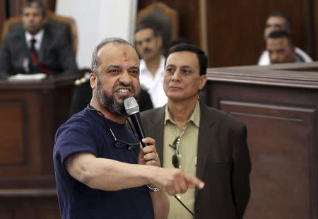 Member of the Muslim Brotherhood Beltagy speaks during his trial at a court in Cairo