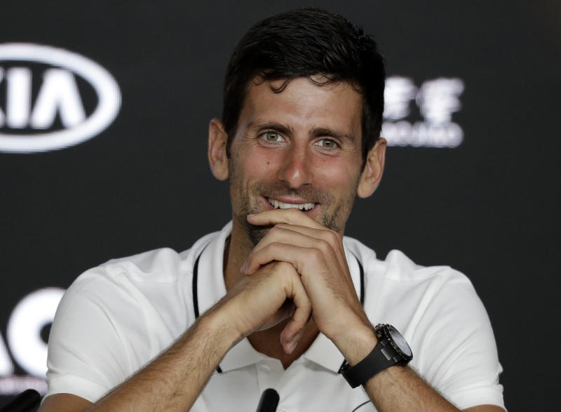Serbia's Novak Djokovic smiles during a press conference at the Australian Open tennis championships in Melbourne, Australia, Sunday, Jan. 13, 2019. (AP Photo/Aaron Favila)