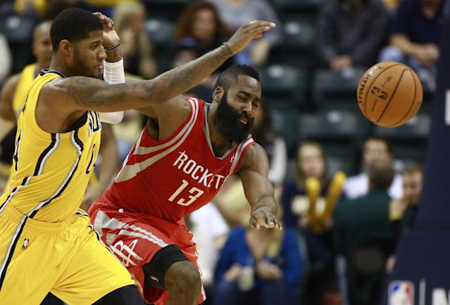 Indiana Pacers forward Paul George, left, and Houston Rockets guard James Harden (13) chase the ball in the second half of an NBA basketball game in Indianapolis, Friday, Dec. 20, 2013. Indiana won 114-81. (AP Photo/R Brent Smith)