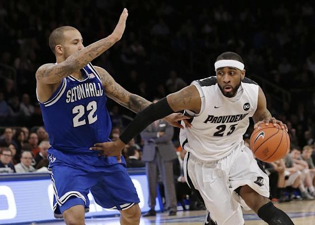 Providence's LaDontae Henton (23) drives past Seton Hall's Brian Oliver (22) during the first half of an NCAA college basketball game in the semifinals of the Big East Conference men's tournament Friday, March 14, 2014, at Madison Square Garden in New York. (AP Photo/Frank Franklin II)