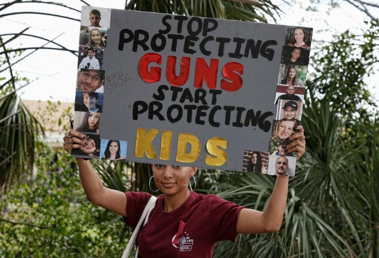 A student holds a sign during a protest against gun violence at Coral Glades High School in Florida