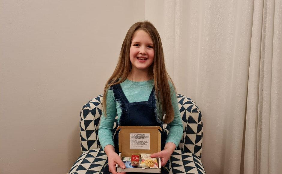 Nine-year-old Lily White used money intended for her birthday party to send 100 lonely OAPs boxes of tea and coffee, and cakes and biscuits. (SWNS)