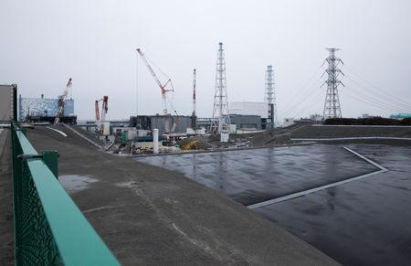 The Unit 2, left to right, Unit 3 and Unit 4 reactor buildings stand at TEPCO's Fukushima Daiichi nuclear power plant in Okuma