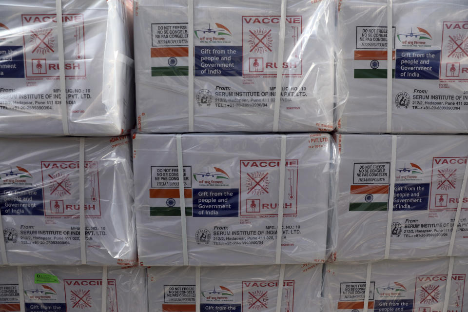 Boxes of the first shipment of 500,000 doses of the AstraZeneca coronavirus vaccine made by Serum Institute of India, donated by the Indian government, await distribution at the customs area of the Hamid Karzai International Airport, in Kabul, Afghanistan, Sunday, Feb. 7, 2021. (AP Photo/Rahmat Gul)
