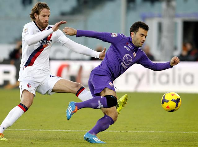 In this Dec. 15, 2013, file photo, Fiorentina's Giuseppe Rossi dribbles past Bologna's Cesare Natali during a Serie A soccer match at Artemio Franchi stadium in Florence, Italy. Rossi and Antonio Cassano were called up for World Cup fitness tests Friday, April 11, 2014, by Italy coach Cesare Prandelli. Rossi was Serie A's top scorer until he re-injured his problematic right knee in January and has only recently begun training again. (AP Photo/Fabrizio Giovannozzi, File)