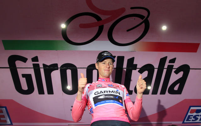 Canadian Garmin team cyclist Ryder Hesjedal raises his thumbs up as he celebrates after winning the Tour of Italy (Giro d'Italia) cycling race on May 27, 2012 in Milano. AFP PHOTO / LUK BENIESLUK BENIES/AFP/GettyImages