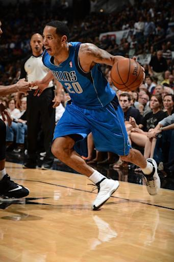 SAN ANTONIO, TX - MAY 4: Devin Harris #20 of the Dallas Mavericks dribbles the ball against the San Antonio Spurs in Game Seven of the Western Conference Quarterfinals during the 2014 NBA Playoffs on MAY 4, 2014 at the AT&T Center in San Antonio, Texas. (Photo by Garrett W. Ellwood/NBAE via Getty Images)