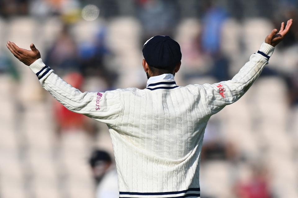 India's Virat Kohli gestures on the final day of the ICC World Test Championship Final between New Zealand and India at the Ageas Bowl in Southampton, southwest England on June 23, 2021. - RESTRICTED TO EDITORIAL USE (Photo by Glyn KIRK / AFP) / RESTRICTED TO EDITORIAL USE (Photo by GLYN KIRK/AFP via Getty Images)