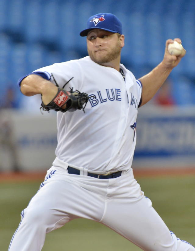 Toronto Blue Jays starting pitcher Mark Buehrle throws against the Los Angeles Angels during the first inning of a baseball game in Toronto on Tuesday, Sept. 10, 2013. (AP Photo/The Canadian Press, Nathan Denette)