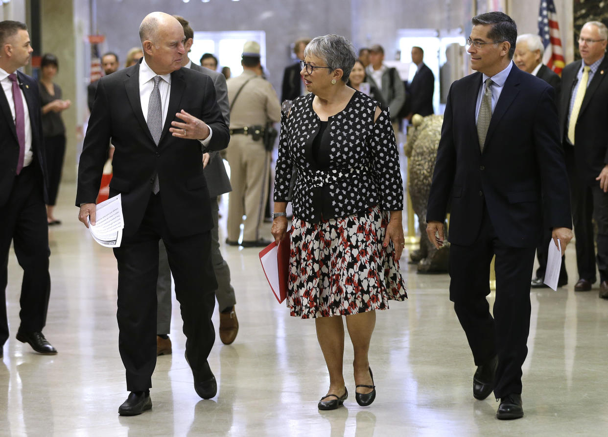 Gov. Jerry Brown, left, talks to California Air Resources Board Chair Mary Nichols and California Attorney General Xavier Becerra as they walk to a news conference to discuss a lawsuit filed by 17 states and the District of Columbia over the Trump administration's plans to scrap vehicle emission standards Tuesday, May 1, 2018, in Sacramento, Calif. (Photo: Rich Pedroncelli/AP)