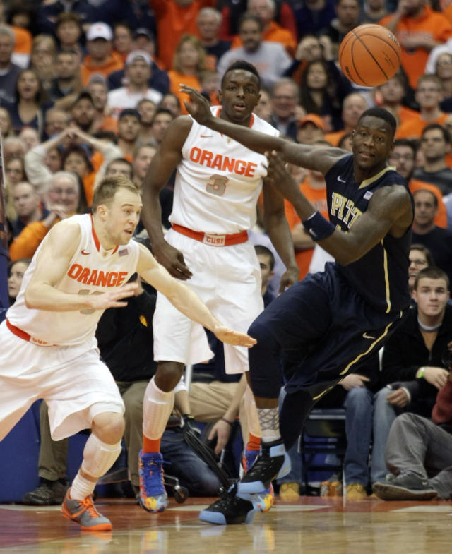 Syracuse Trevor Cooney, left, Jerami Grant, center, and Pittsburgh's Talib Zanna battle for a loose ball late in the second half of an NCAA college basketball game in Syracuse, N.Y., Saturday, Jan. 18, 2014. Syracuse won 59-54. (AP Photo/Nick Lisi)