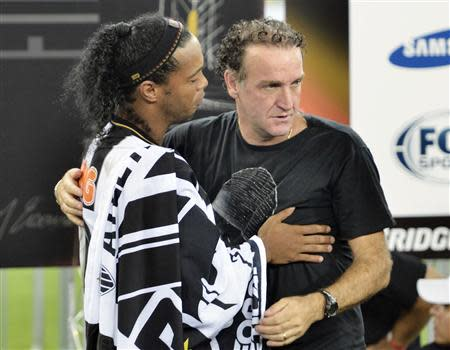 Ronaldinho of Brazil's Atletico Mineiro and team coach Cuca celebrate after winning their Copa Libertadores second leg final soccer match against Paraguay's Olimpia in Belo Horizonte