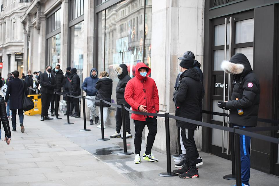 <p>Some shoppers wear face masks as they queue outside Nike Town</p>Jeremy Selwyn