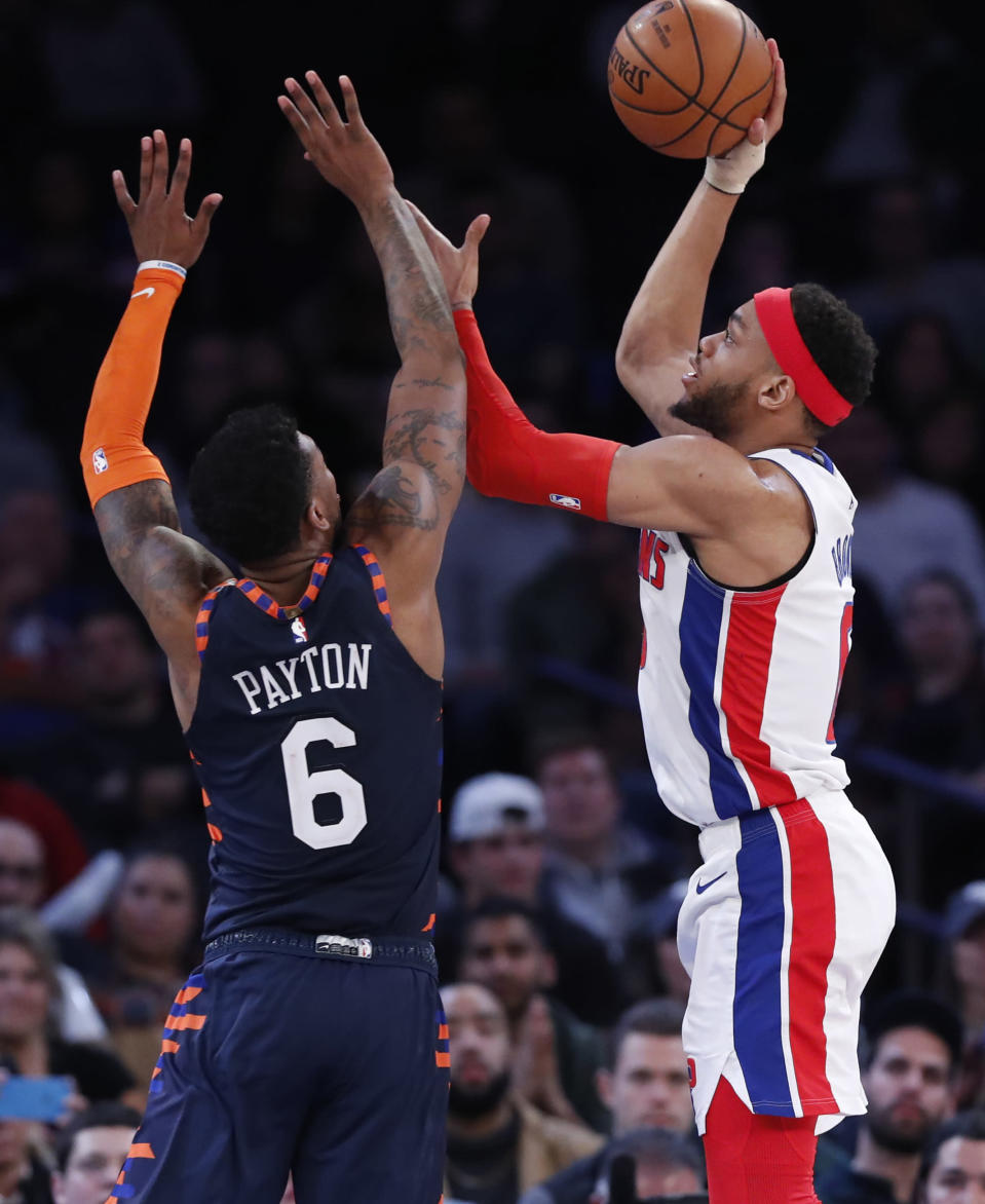 New York Knicks guard Elfrid Payton (6) defends Detroit Pistons guard Bruce Brown (6) as Brown shoots during the second half of an NBA basketball game in New York, Sunday, March 8, 2020. The Knicks defeated the Pistons 96-84. (AP Photo/Kathy Willens)