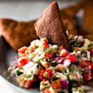 <p>This roasted eggplant and feta dip gets a kick from a fresh chile pepper and cayenne pepper. There are countless variations on this classic Greek dip. Out-of-season eggplant or eggplant that has been heavily watered often has an abundance of seeds, which make the vegetable bitter. Be sure to taste the dip before you serve it; if it's a touch bitter, you can remedy that with a little sugar. Serve with toasted pita crisps or as a sandwich spread.</p>