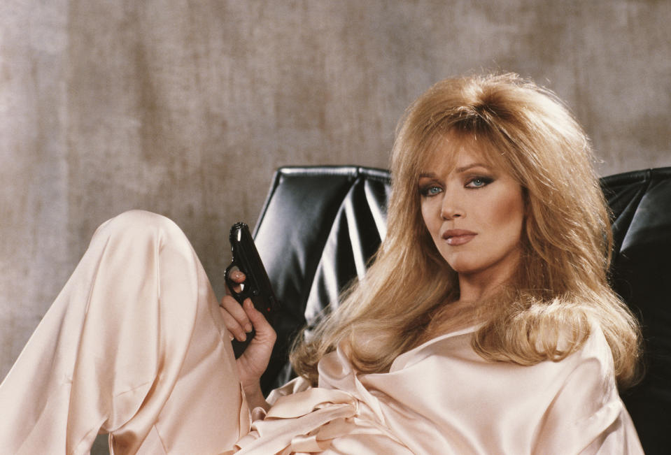 American actress Tanya Roberts stars as Stacey Sutton in the James Bond film 'A View To A Kill', 1984. She is holding Bond's trademark Walther PPK. (Photo by Keith Hamshere/Getty Images)