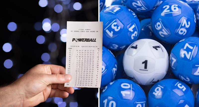 A Powerball ticket being held next to Powerball balls.