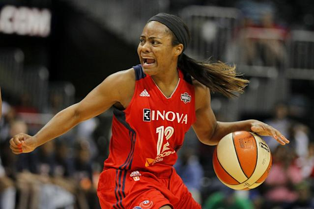 Washington Mystics guard Ivory Latta (12) drives against the Atlanta Dream during the second half in Game 1 of theirWNBA basketball Eastern Conference semifinals playoff series, Thursday, Sept. 19, 2013, in Atlanta. The Mystics won 71-56. (AP Photo/Todd Kirkland)