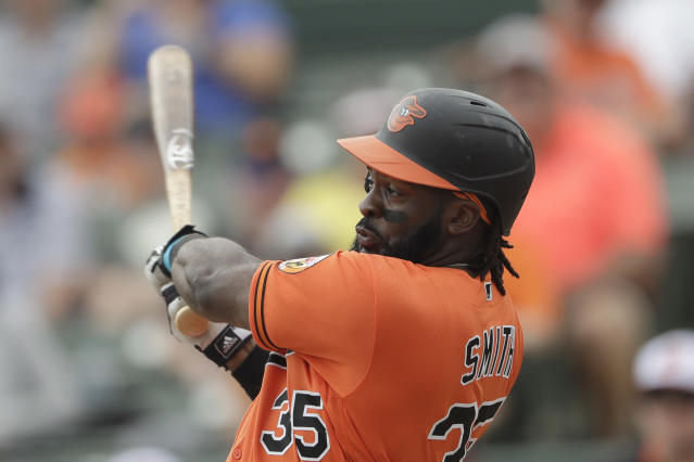 Baltimore Orioles left fielder Dwight Smith Jr. (35) bats against the Tampa Bay Rays during a spring training baseball game Monday, March 2, 2020, in Sarasota, Fla. (AP Photo/John Bazemore)