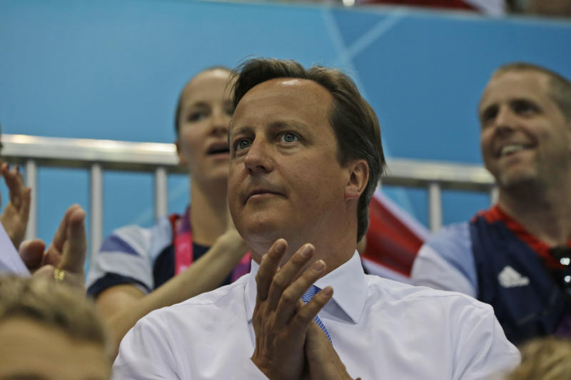Booed at games, Cameron sticks to austerity drive