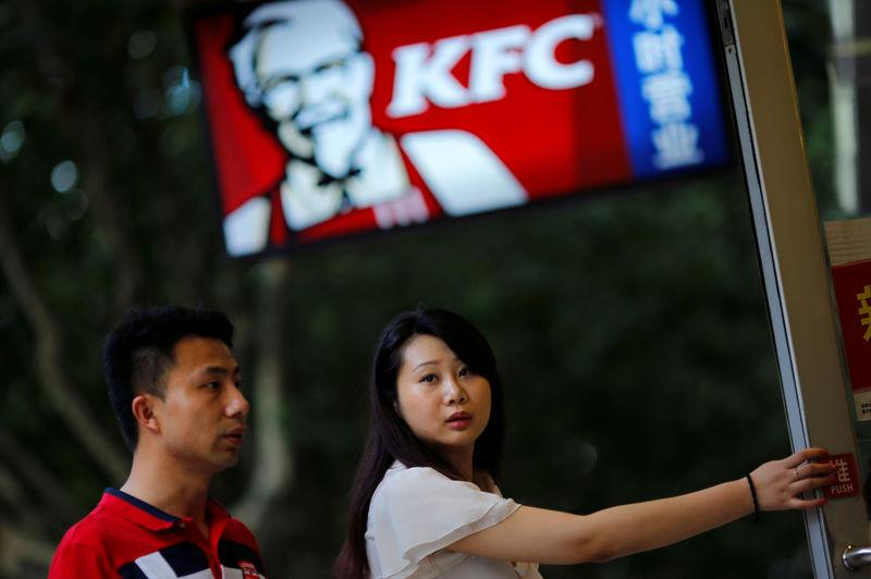 FILE PHOTO: Customers walk into a KFC store in downtown Shanghai