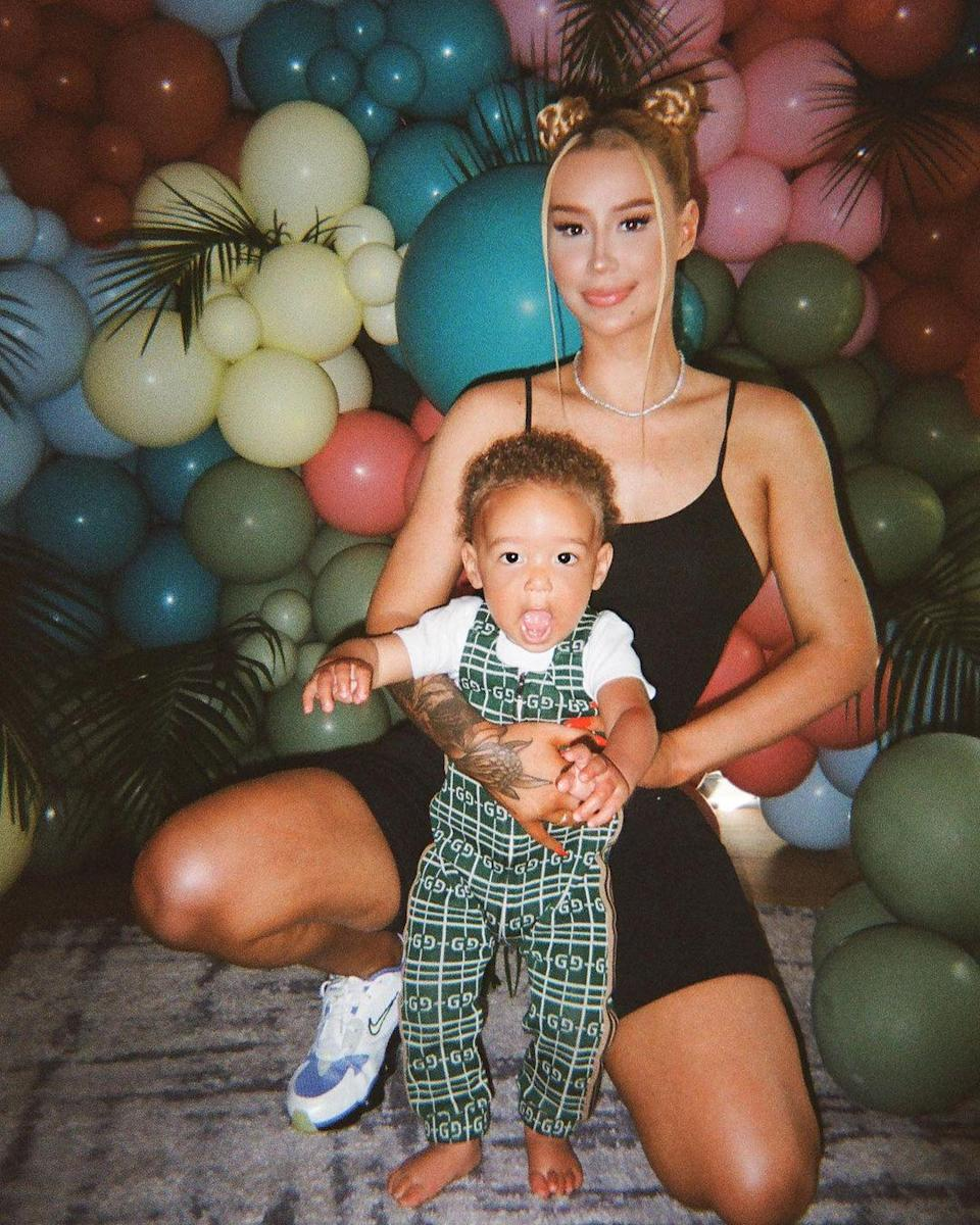 """<p><a href=""""https://people.com/tag/iggy-azalea/"""" rel=""""nofollow noopener"""" target=""""_blank"""" data-ylk=""""slk:Iggy Azalea"""" class=""""link rapid-noclick-resp"""">Iggy Azalea</a> is devoted to being a good mother to her son.</p> <p>Azalea is mom to one-year-old Onyx who she shares with ex, rapper <a href=""""https://people.com/parents/iggy-azalea-son-onyx-both-parents-in-life-playboi-carti/"""" rel=""""nofollow noopener"""" target=""""_blank"""" data-ylk=""""slk:Playboi Carti."""" class=""""link rapid-noclick-resp"""">Playboi Carti. </a>The """"Fancy"""" rapper first revealed she was a mom via Instagram last June. </p> <p>""""I have a son,"""" Azalea began in a message on her <a href=""""https://www.instagram.com/thenewclassic/?hl=en"""" rel=""""nofollow noopener"""" target=""""_blank"""" data-ylk=""""slk:Instagram"""" class=""""link rapid-noclick-resp"""">Instagram </a>story. """"I kept waiting for the right time to say something, but it feels like the more time passes, the more I realize I'm always going to feel anxious to share news that giant with the world.""""</p> <p>In April, the artist shared an adorable Instagram post in <a href=""""https://people.com/parents/iggy-azalea-calls-son-onyx-favorite-person-first-birthday-photo/"""" rel=""""nofollow noopener"""" target=""""_blank"""" data-ylk=""""slk:honor of her son's special day"""" class=""""link rapid-noclick-resp"""">honor of her son's special day</a>.</p> <p>""""Happy 1st Birthday to my favorite person in the entire universe! 💖,"""" the singer wrote. """"I never thought I could love anything or anyone this much, Onyx you're a joy. Your happiness is my happiness.""""</p>"""