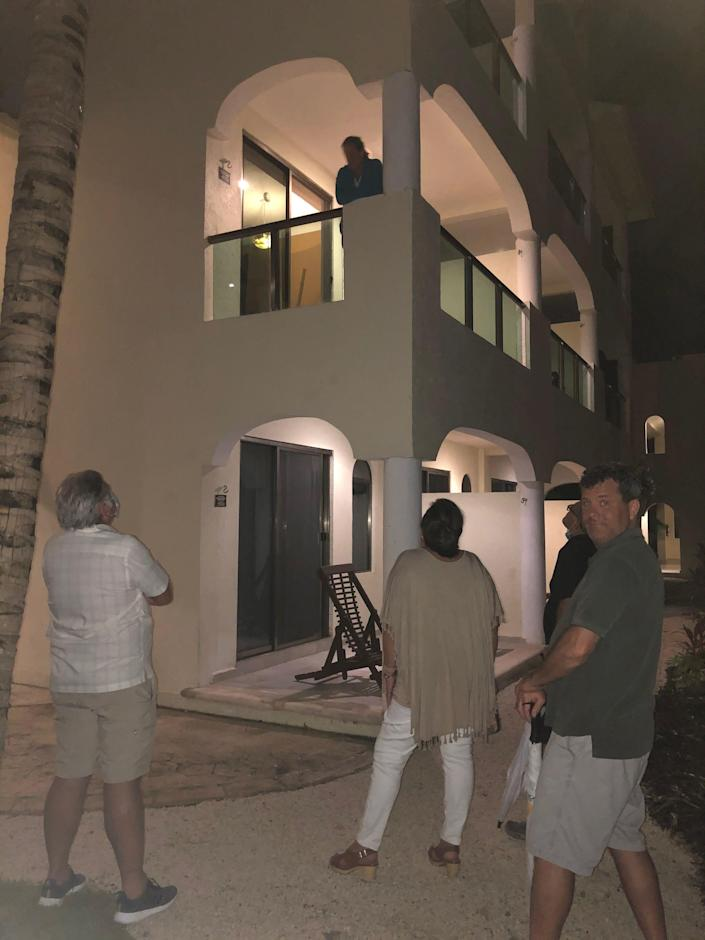 Lucia Rooney talks to friends and family members from her balcony during COVID isolation at El Dorado Casitas Royale resort in Riviera Maya, Mexico.
