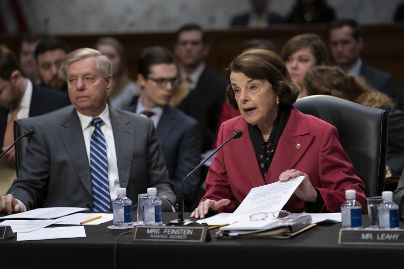 Senate Judiciary Committee Chairman Lindsey Graham R-S.C. listens at left as Sen. Dianne Feinstein D-Calif. the ranking member objects to advancing the nomination of Bill Barr to be attorney general on Capitol Hill in Washington Thursday Feb. 7 2