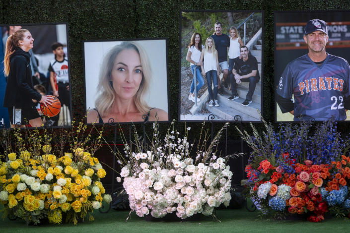 FILE - In this Feb. 10, 2020, file photo, flowers and photos honor members of the Altobelli family outside Angel Stadium in Anaheim, Calif. Coach John Altobelli, 56, far right, his wife, Keri, 43, second from left, and his daughter Alyssa, 13, left, died in a helicopter crash on Jan. 26 in Calabasas, Calif. Autopsy reports released Friday, May 15, 2020, show that the pilot who flew basketball icon Kobe Bryant did not have drugs or alcohol in his system when the helicopter crashed in Southern California in January, killing all nine aboard. The causes of death for Bryant, his 13-year-old daughter Gianna, pilot Ara Zobayan and the others have been ruled blunt force trauma. Federal authorities are still investigating the Jan. 26 incident where the chopper crashed into the Calabasas hillsides. (AP Photo/Damian Dovarganes, File)