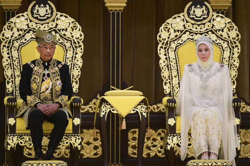 In this photo released by Malaysia's Department of Information, Malaysia's King Sultan Abdullah Sultan Ahmad Shah and Queen Tunku Azizah attend the royal coronation at the National Palace in Kuala Lumpur Tuesday, July 30, 2019. Malaysia's new king called for racial unity as he was formally installed as the country's 16th king under a unique rotating monarchy system. (Malaysia Information Ministry via AP)