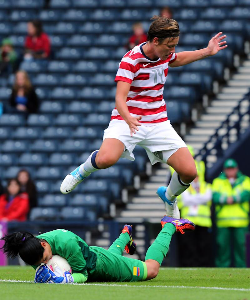 GLASGOW, SCOTLAND - JULY 28: Sandra Sepulveda (L) of Columbia grabs the ball away from Abby Wambach of USA during the Women's Football first round Group G match between United States and Colombia on Day 1 of the London 2012 Olympic Games at Hampden Park on July 28, 2012 in Glasgow, Scotland.  (Photo by Stanley Chou/Getty Images)