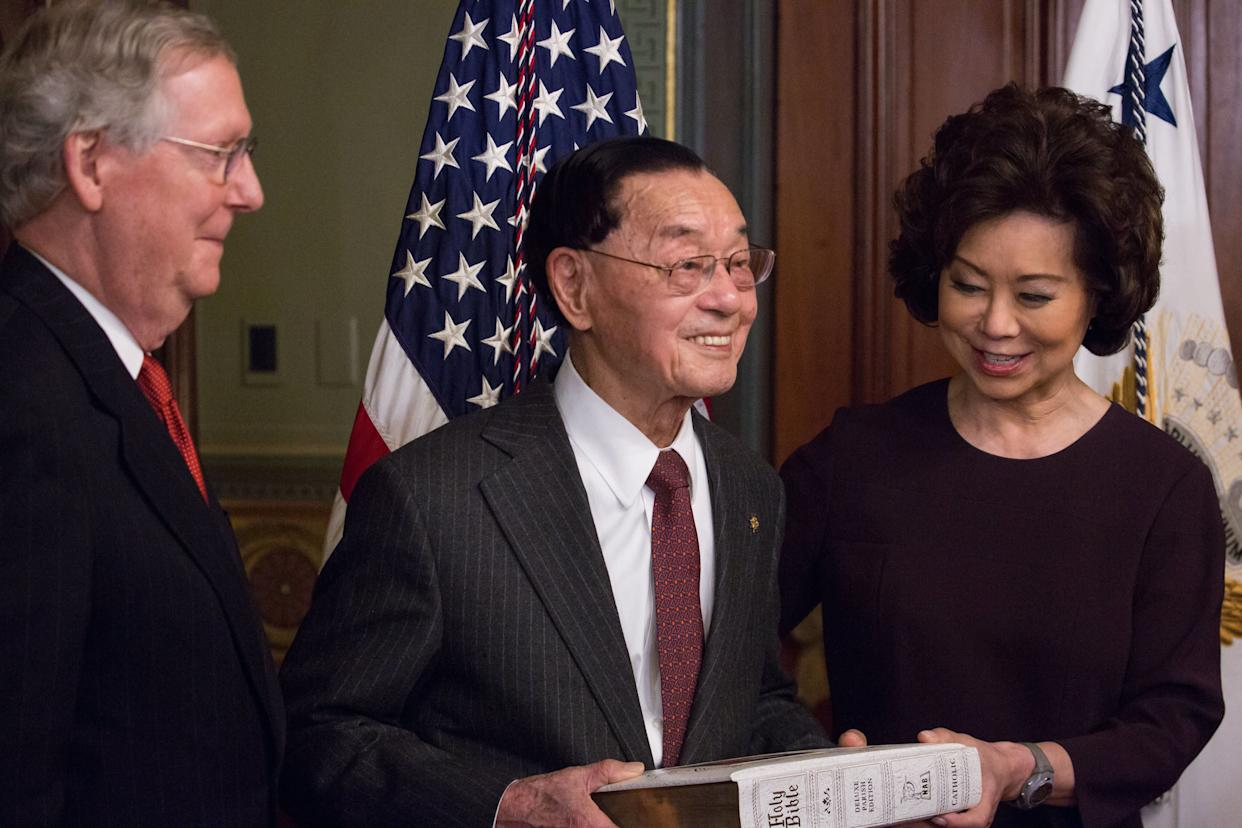 Elaine Chao is seen being sworn in as the transportation secretary with her father, James Chao, holding a Bible. Her husband, Senate Majority Leader Mitch McConnell, bears witness. (Photo: NurPhoto via Getty Images)