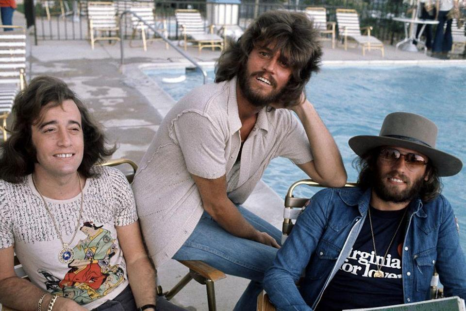 <p>The Bee Gees hang at the pool in 1974. </p>