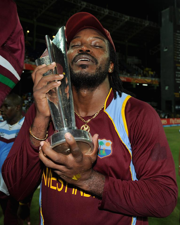 COLOMBO, SRI LANKA - OCTOBER 07:  Chris Gayle of the West Indies celebrates with the trophy after winning the ICC World Twenty20 2012 Final between Sri Lanka and the West Indies at R. Premadasa Stadium on October 7, 2012 in Colombo, Sri Lanka.  (Photo by Gareth Copley/Getty Images)