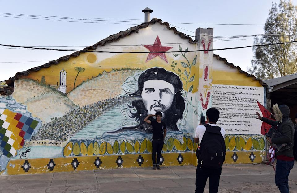 Murals of Che are on the walls around Vallegrande, just as they are in Cuba: AFP/Getty Images