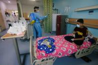A worker wearing protective gear sprays disinfectant at the Children's Hospital for Cancer Diseases in Basra