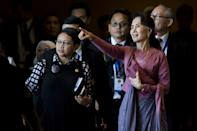 Myanmar's de facto civilian leader Aung San Suu Kyi (right) attends the Association of Southeast Asian Nations foreign ministers' meeting in Yangon on December 19, 2016