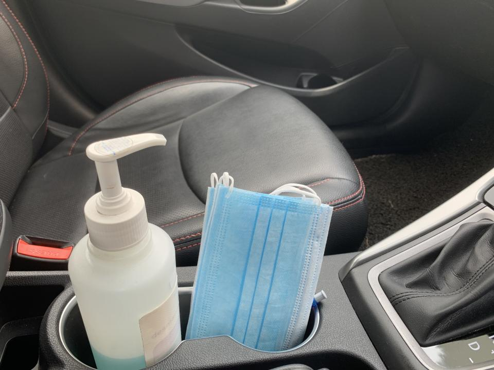 Hand sanitizer and face mask placed in the car