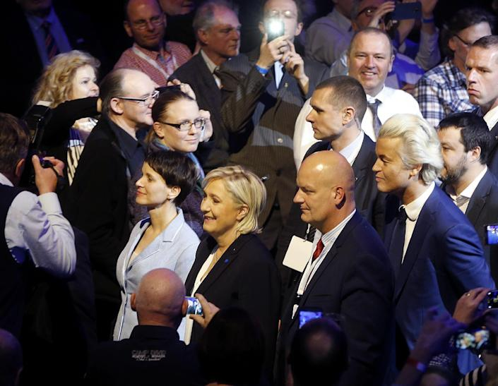 AfD (Alternative for Germany) chairwoman Frauke Petry, left, Far-right leader and candidate for next spring presidential elections Marine le Pen from France, second left, and Dutch populist anti-Islam lawmaker Geert Wilders, right, enter the room at the beginning of a meeting of European Nationalists in Koblenz, Germany, Saturday, Jan. 21, 2017. (AP Photo/Michael Probst)