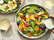 """<p>This abundantly loaded salad is the ultimate love letter to summer. Featuring a colorful menagerie of seasonal gems-blueberries, tomatoes, corn, cucumbers, okra, and more-it's as gorgeous as it is delicious. Plus, this <a href=""""https://www.myrecipes.com/salad-recipes"""" rel=""""nofollow noopener"""" target=""""_blank"""" data-ylk=""""slk:salad"""" class=""""link rapid-noclick-resp"""">salad</a> absolutely flexible. Consider this recipe a blueprint for bringing together everything that catches your eye at your own local farmer's market this week. But do yourself a huge favor-do not skip out on making the Vidalia Onion Ranch Dressing. This homemade dressing will keep you from ever going back to the bottled stuff. Shredded rotisserie or leftover grilled chicken would be a welcome addition to make for a heartier, main-dish salad. </p>"""