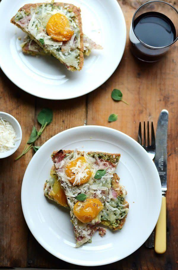 """<strong>Get the <a href=""""http://www.versesfrommykitchen.com/2011/10/parmesan-flatbread-with-dandelion-green-onion-pesto-sopressa-prosciutto-parmesan-golden-cherry-tomatoes.html"""" rel=""""nofollow noopener"""" target=""""_blank"""" data-ylk=""""slk:Parmesan Flatbread with Mozza & Golden Cherry Tomatoes recipe"""" class=""""link rapid-noclick-resp"""">Parmesan Flatbread with Mozza & Golden Cherry Tomatoes recipe</a> from Verses from my Kitchen</strong>"""