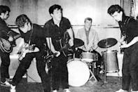 <p>Rocking out with the Silver Beatles - an early version of the band - in Liverpool in 1960. The group included future Beatles John Lennon (left) and George Harrison (right).</p>