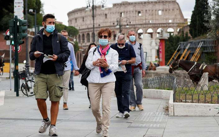 Italy has now made mask wearing compulsory outside - Reuters