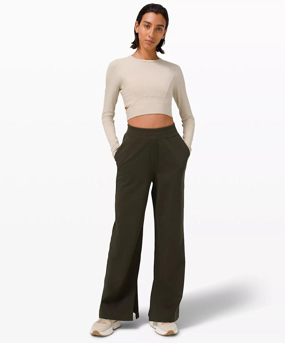"""<h2>Lululemon LA Wide Leg Side Split High-Rise Pant</h2><br>Remember what we said about wide legs being a smart choice? These side-split pants take it to the next level with slits on the inside that allow for better movement. And don't forget the naturally breathable cotton terry fabric, which your legs will thank you for once that stuffy airplane air starts to feeling overwhelmingly warm. <br><br><em>Shop <strong><a href=""""https://shop.lululemon.com/"""" rel=""""nofollow noopener"""" target=""""_blank"""" data-ylk=""""slk:Lululemon"""" class=""""link rapid-noclick-resp"""">Lululemon</a></strong></em><br><br><strong>Lululemon</strong> LA Wide Leg Side Split High-Rise Pant, $, available at <a href=""""https://go.skimresources.com/?id=30283X879131&url=https%3A%2F%2Fshop.lululemon.com%2Fp%2Fwomen-pants%2FLA-Wide-Leg-Side-Split-HR-Pant%2F_%2Fprod10390102%3Fcolor%3D26083"""" rel=""""nofollow noopener"""" target=""""_blank"""" data-ylk=""""slk:Lululemon"""" class=""""link rapid-noclick-resp"""">Lululemon</a>"""
