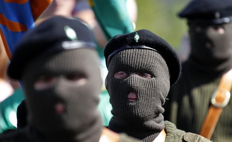 Masked members of the Real Irish Republican Army (RIRA) splinter group parade during a 1916 Easter Rising commemoration at Cregan Cemetery in Londonderry in 2011. (Photo: ASSOCIATED PRESS)